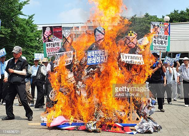 South Korean conservative activists burn effigies of North Korea's founder Kim IlSung late leader Kim JongIl and present leader Kim JongUn during an...