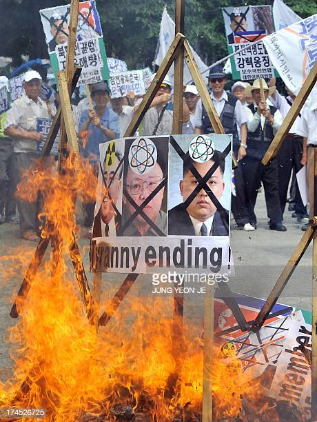 South Korean conservative activists burn portraits of North Korea's founder Kim IlSung late leader Kim JongIl and present leader Kim JongUn during an...