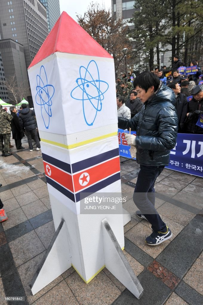 A South Korean conservative activists carries a mock North Korean nuclear missile during a protest against North Korea's threat of its nuclear test, in Seoul on February 6, 2013. North Korea warned on February 5 of making a move 'beyond imagination,' as the communist state ramps up daily threats of an apparently imminent nuclear test. The banner reads 'A rally denouncing the threat of the 3rd nuclear test by North Korea'.