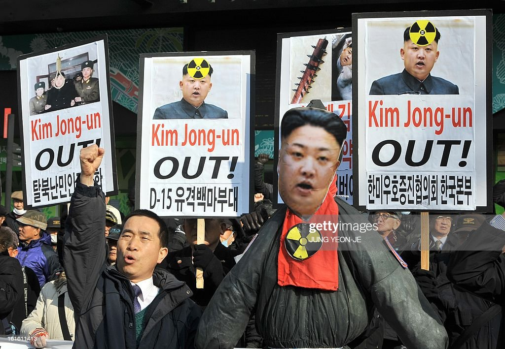 South Korean conservative activists display placards and shout slogans behind an effigy of North Korean leader Kim Jong-Un (C) during a rally denouncing North Korea's nuclear test, in Seoul on February 13, 2013. South Korea said on February 13 it would accelerate the development of longer-range ballistic missiles that could cover the whole of North Korea in response to a third nuclear test by Pyongyang.
