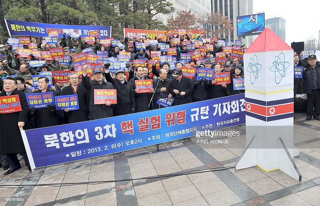 South Korean conservative activists hold a protest against North Korea's threat of its nuclear test, in Seoul on February 6, 2013. North Korea warned on February 5 of making a move 'beyond imagination,' as the communist state ramps up daily threats of an apparently imminent nuclear test. The banner reads 'A rally denouncing the threat of the 3rd nuclear test by North Korea'.