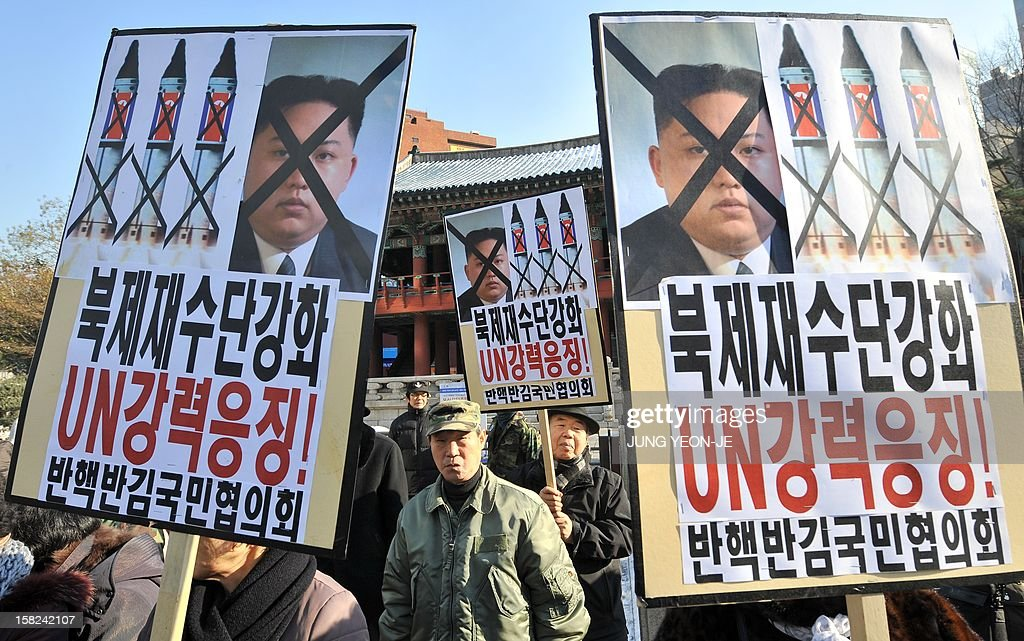 South Korean conservative activists hold anti-North Korea placards reading 'Strengthen UN sanctions against North Korea,' during a protest denouncing North Korea's rocket launch, in Seoul on December 12, 2012. North Korea's rocket launch is evidence of a new ballistic missile capability that sharply raises the stakes over Pyongyang's nuclear programme and poses a direct threat to the United States, analysts say.