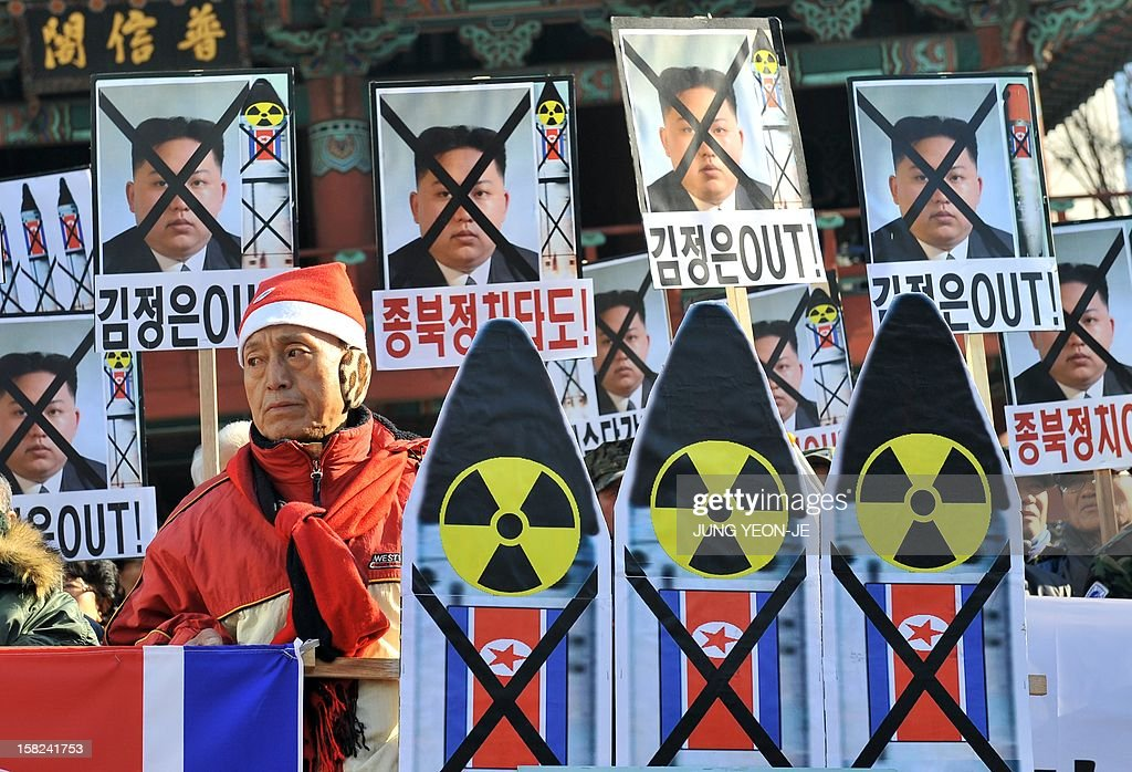 South Korean conservative activists hold anti-North Korean placards during a protest denouncing North Korea's rocket launch, in Seoul on December 12, 2012. North Korea's rocket launch is evidence of a new ballistic missile capability that sharply raises the stakes over Pyongyang's nuclear programme and poses a direct threat to the United States, analysts say.