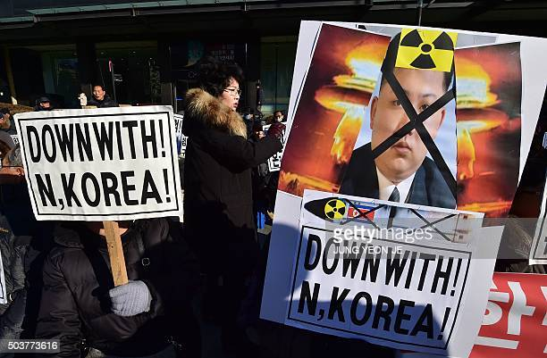 South Korean conservative activists hold placards showing a portrait of North Korean leader Kim JongUn during a rally denouncing North Korea's...