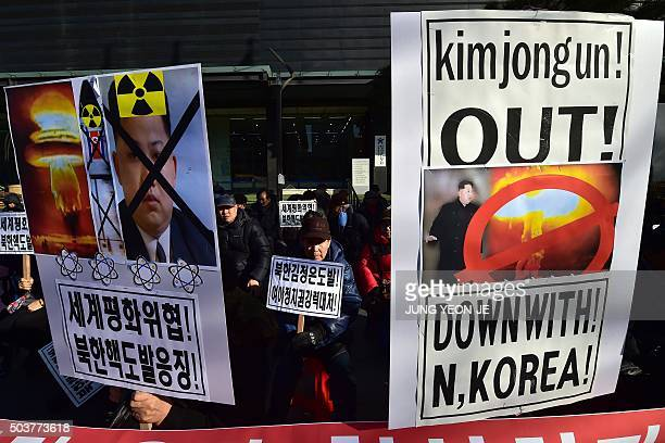 South Korean conservative activists hold placards showing portraits of North Korean leader Kim JongUn during a rally denouncing North Korea's...
