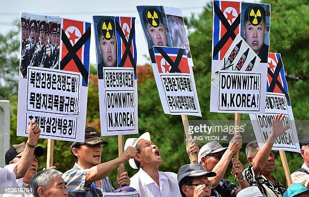 South Korean conservative activists hold up placards showing portraits of North Korean leader Kim JongUn during an antiNorth Korea rally denouncing...