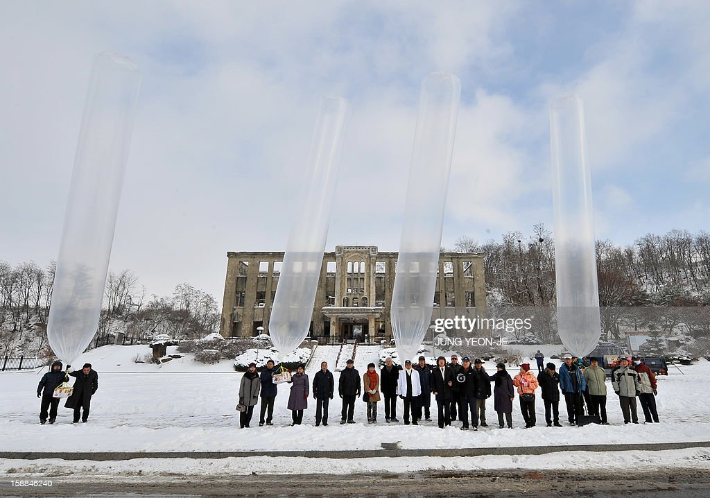 South Korean conservative activists release balloons carrying anti-North Korea leaflets in front of former North Korean Labor Party Cheorwon Office Building in the South Korean border county of Che...