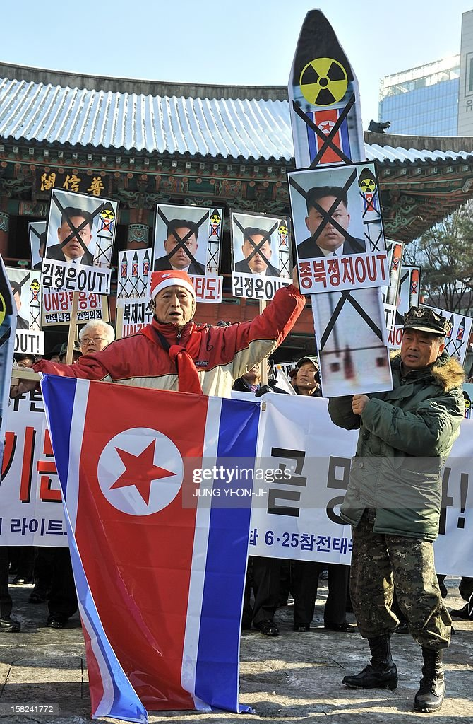 South Korean conservative activists shout slogans with anti-North Korean placards during a protest denouncing North Korea's rocket launch, in Seoul on December 12, 2012. North Korea's rocket launch is evidence of a new ballistic missile capability that sharply raises the stakes over Pyongyang's nuclear programme and poses a direct threat to the United States, analysts say.