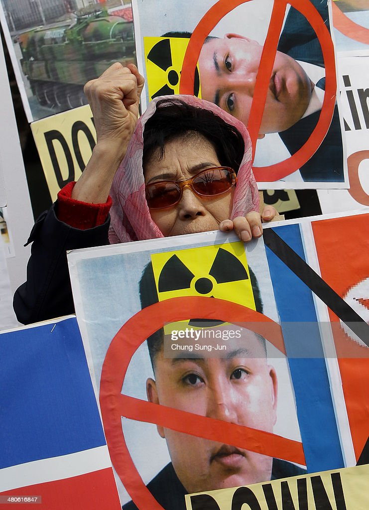 A South Korean conservative protester shout slogans during a anti-North Korea rally on March 26, 2014 in Seoul, South Korea. North Korea test-launched two Nodong medium-range ballistic missiles into the sea off Korean peninsula's east coast on Wednesday morning, according to South Korea's defence ministry.