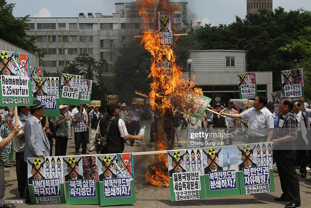 South Korean conservative protesters burn a mock of North Korea's missile and anti-North Korea placards during an anti-North Korea rally to mark 63rd anniversary of the Korean war on June 24, 2013 in Seoul, South Korea. The Korean War started on June 25, 1950 when the North Korean military advanced on its southern neighbour.