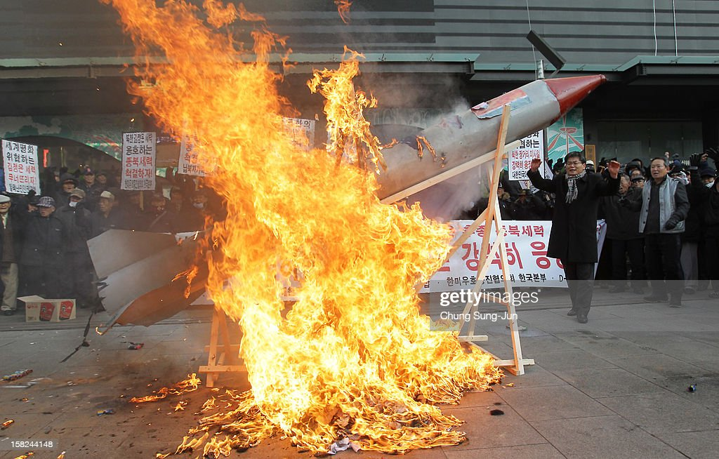 South Korean conservative protesters burn a mockup of a North Korean missile and portraits of North Korean leader Kim Jong-Un during an anti-North Korea rally demonstrating against North Korea having launched a long-range missile on December 12, 2012 in Seoul, South Korea. North Korea launched a long range missile at 9:49am local time.
