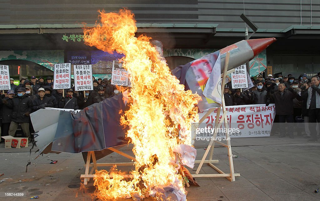 South Korean conservative protesters burn a mockup of a North Korean missile and portraits of North Korean leader Kim Jong-Un during an anti-North Korea rally demonstrating against North Korea having launched a long-range missile on December 12, 2012 in Seoul, South Korea. North Korea launched a long range missile on 9:49am local time.