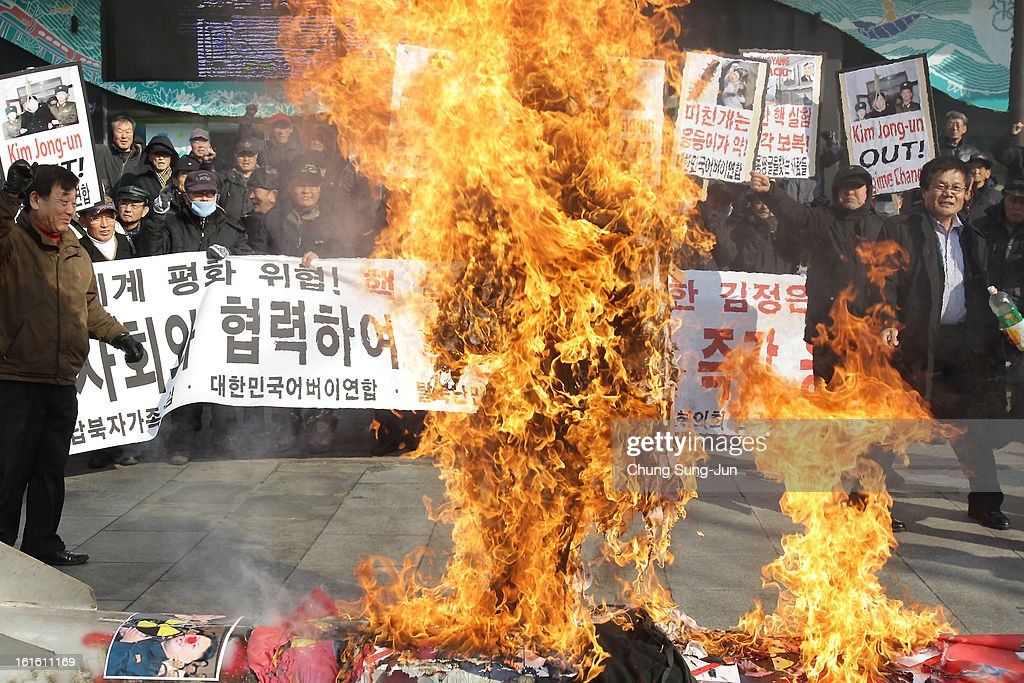 South Korean conservative protesters burn a North Korean flag and effigy of North Korean leader Kim Jong-Un during an anti-North Korea rally a day after North Korea announced they have conducted a third nuclear test on February 13, 2013 in Seoul, South Korea. North Korea claimed the device was smaller than in previous tests. Leaders around the world have condemned the nuclear test and have called for swift action against the reclusive country.
