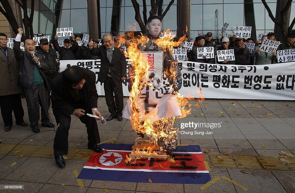 South Korean conservative protesters burn an effigy of North Korean leader Kim JongUn and a North Korean flag during an antiNorth rally commemorating...
