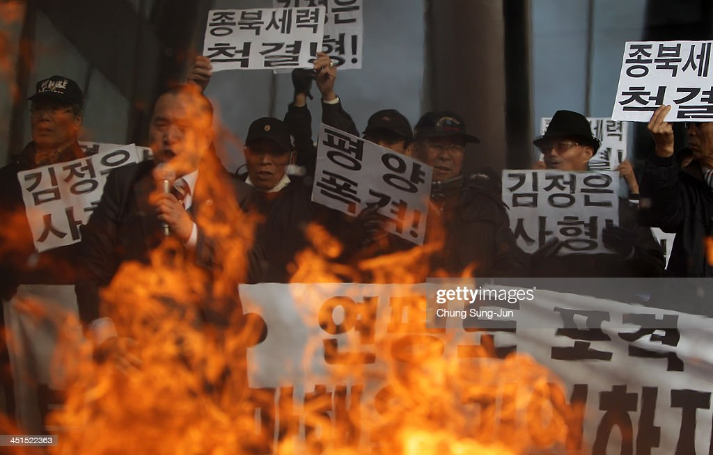 South Korean conservative protesters burn an effigy of North Korean leader Kim JongUn and flags during an antiNorth rally commemorating the four...