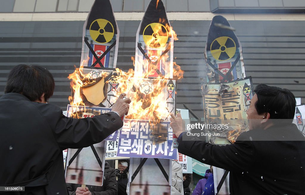 South Korean conservative protesters burn anti-North Korea placards during a rally demonstrating against North Koreas nuclear test on February 12, 2013 in Seoul, South Korea. North Korea confirmed it had successfully carried out an underground nuclear test as a shallow earthquake with a magnitude of 4.9 was detected by several international monitoring agencies. South Korea and Japan both assembled an emergency meeting of their respective national security teams after the incident.