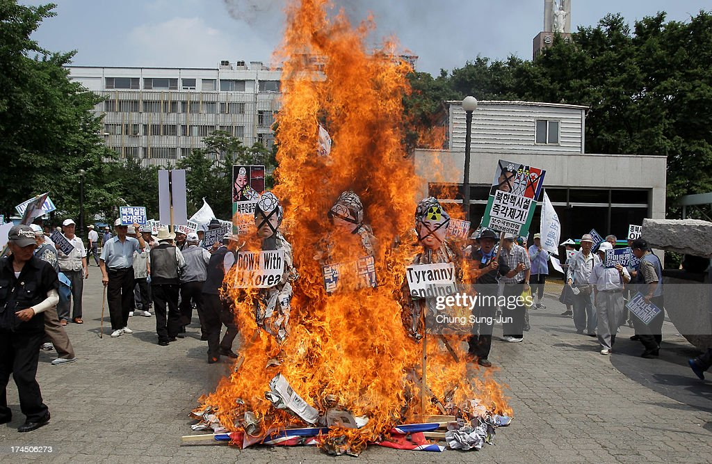 South Korean conservative protesters burn effigies of North Korea national founder Kim Il-Sung, former North Korean leader Kim Jong-Il and now leader Kim Jong-Un during an anti North Korea rally on July 27, 2013 in Seoul, South Korea. On June 25, 1950, soldiers of the North Korean army breached the 38th parallel invading the Republic of South Korea, marking the beginning of the Korean War. On July 27, 1953, a signed armistice agreement brought the three-year conflict to an end.