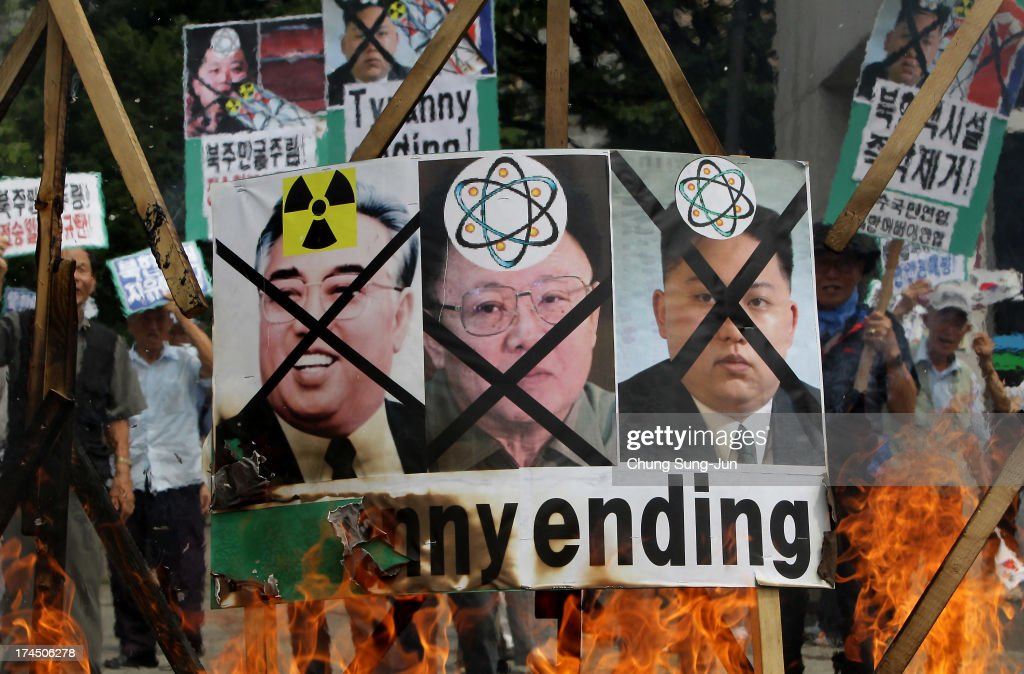 South Korean conservative protesters burn portraits of North Korea national founder Kim Il-Sung, former North Korean leader Kim Jong-Il and now leader Kim Jong-Un during an anti North Korea rally on July 27, 2013 in Seoul, South Korea. On June 25, 1950, soldiers of the North Korean army breached the 38th parallel invading the Republic of South Korea, marking the beginning of the Korean War. On July 27, 1953, a signed armistice agreement brought the three-year conflict to an end.