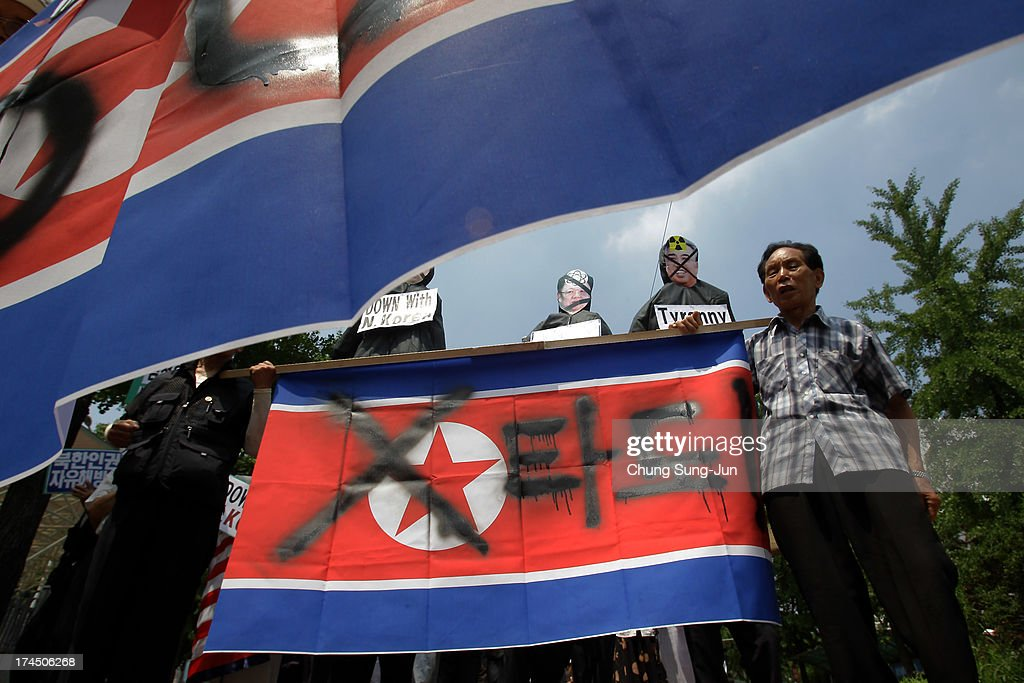 South Korean conservative protesters participate in a anti North Korea rally on July 27, 2013 in Seoul, South Korea. On June 25, 1950, soldiers of the North Korean army breached the 38th parallel invading the Republic of South Korea, marking the beginning of the Korean War. On July 27, 1953, a signed armistice agreement brought the three-year conflict to an end.