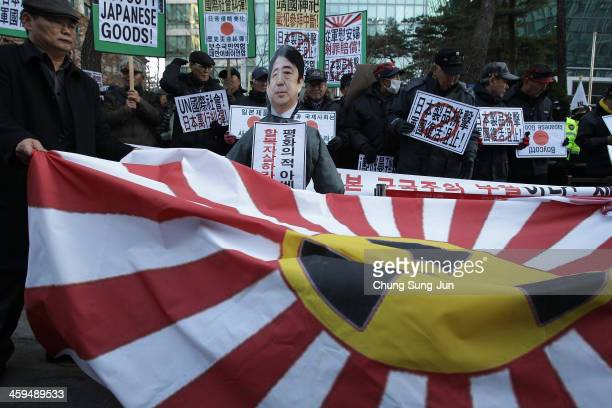 South Korean conservative protesters participate in a antiJapan rally in front of the Japanese embassy on December 27 2013 in Seoul South Korea On...