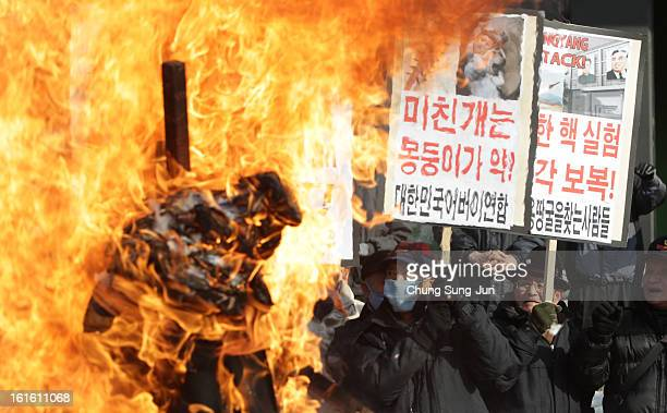 South Korean conservative protesters participate in a rally a day after North Korea announced they have conducted a third nuclear test on February 13...