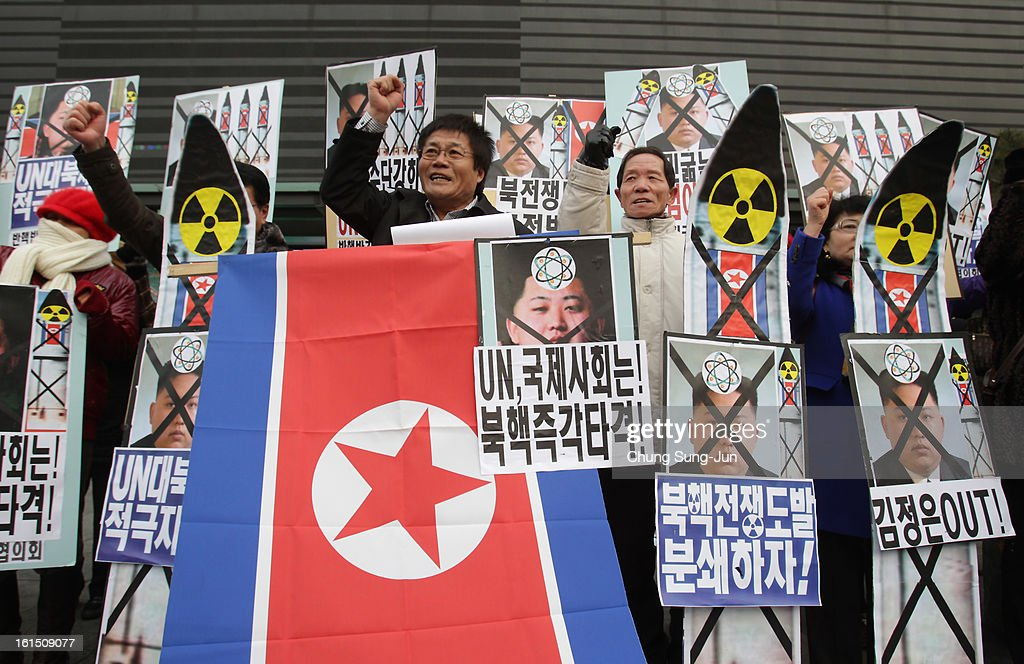 South Korean conservative protesters participate in a rally demonstrating against North Koreas nuclear test on February 12, 2013 in Seoul, South Korea. North Korea confirmed it had successfully carried out an underground nuclear test as a shallow earthquake with a magnitude of 4.9 was detected by several international monitoring agencies. South Korea and Japan both assembled an emergency meeting of their respective national security teams after the incident.