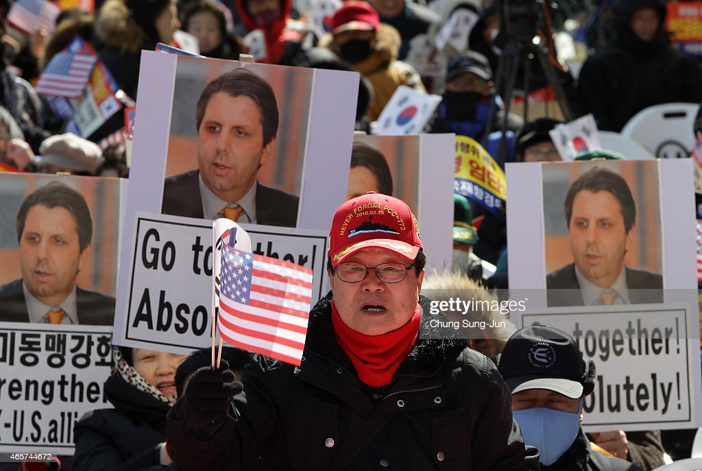 South Korean conservative protesters participate in a rally denouncing the attack on U.S. Ambassador to South Korea <a gi-track='captionPersonalityLinkClicked' href=/galleries/search?phrase=Mark+Lippert&family=editorial&specificpeople=5797334 ng-click='$event.stopPropagation()'>Mark Lippert</a> on March 10, 2015 in Seoul, South Korea. The conservative protesters claim for stronger South Korea and U.S. Alliance despite last week's attack on Lippert by a knife carrying South Korean man at a breakfast function in central Seoul on March 5.