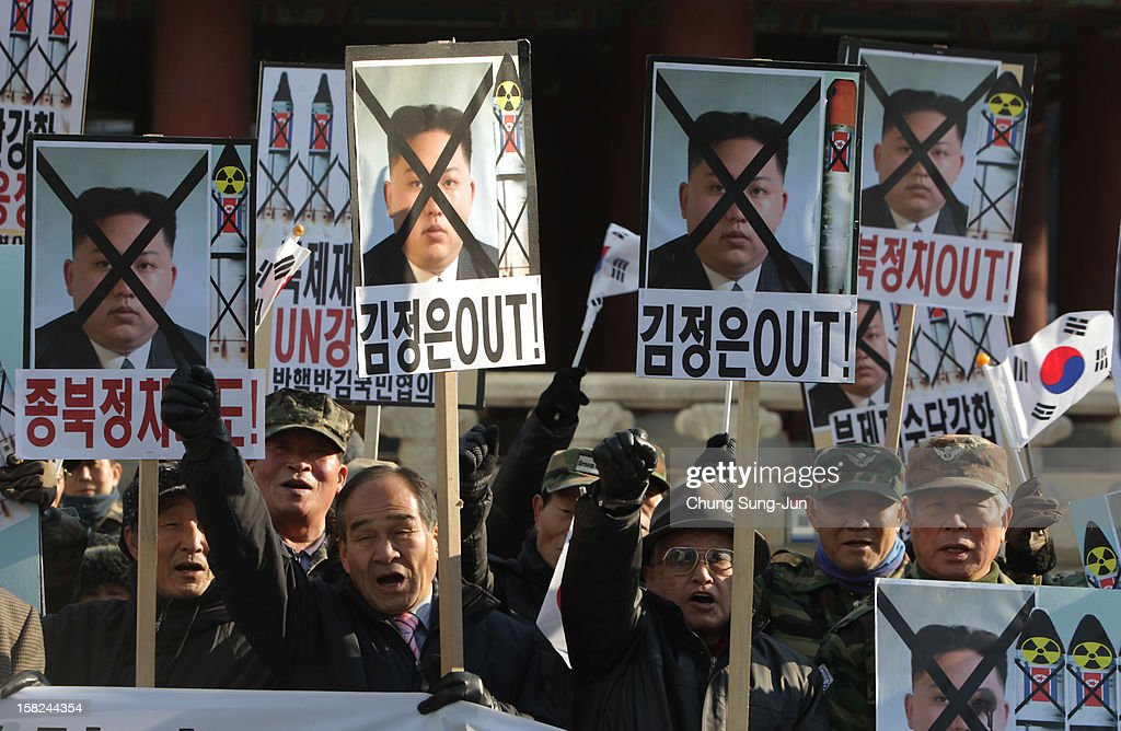 South Korean conservative protesters participate in an anti-North Korea rally reacting to North Korea launching the long-range missile on December 12, 2012 in Seoul, South Korea. North Korea launched a long range missile on 9:49am local time.