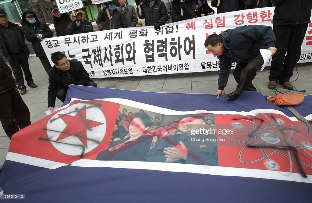 South Korean conservative protesters position a defaced North Korean flag as they participate in a rally demonstrating against North Korea's nuclear test on February 12, 2013 in Seoul, South Korea. North Korea confirmed it had successfully carried out an underground nuclear test, as a shallow earthquake with a magnitude of 4.9 was detected by several international monitoring agencies. South Korea and Japan both assembled an emergency meeting of their respective national security teams after the incident.