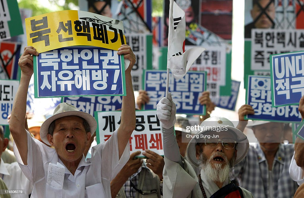 South Korean conservative protesters shout slogans during a anto North Korea rally on July 27, 2013 in Seoul, South Korea. On June 25, 1950, soldiers of the North Korean army breached the 38th parallel invading the Republic of South Korea, marking the beginning of the Korean War. On July 27, 1953, a signed armistice agreement brought the three-year conflict to an end.