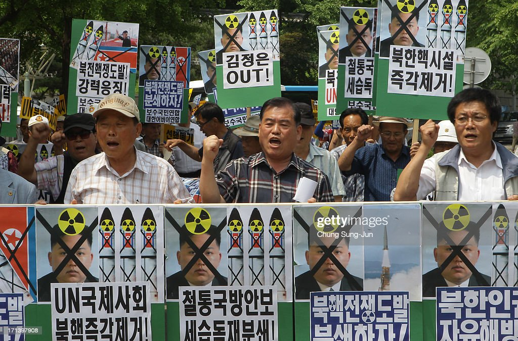 South Korean conservative protesters shout their slogans during an anti-North Korea rally to mark 63rd anniversary of the Korean war on June 24, 2013 in Seoul, South Korea. The Korean War started on June 25, 1950 when the North Korean military advanced on its southern neighbour.