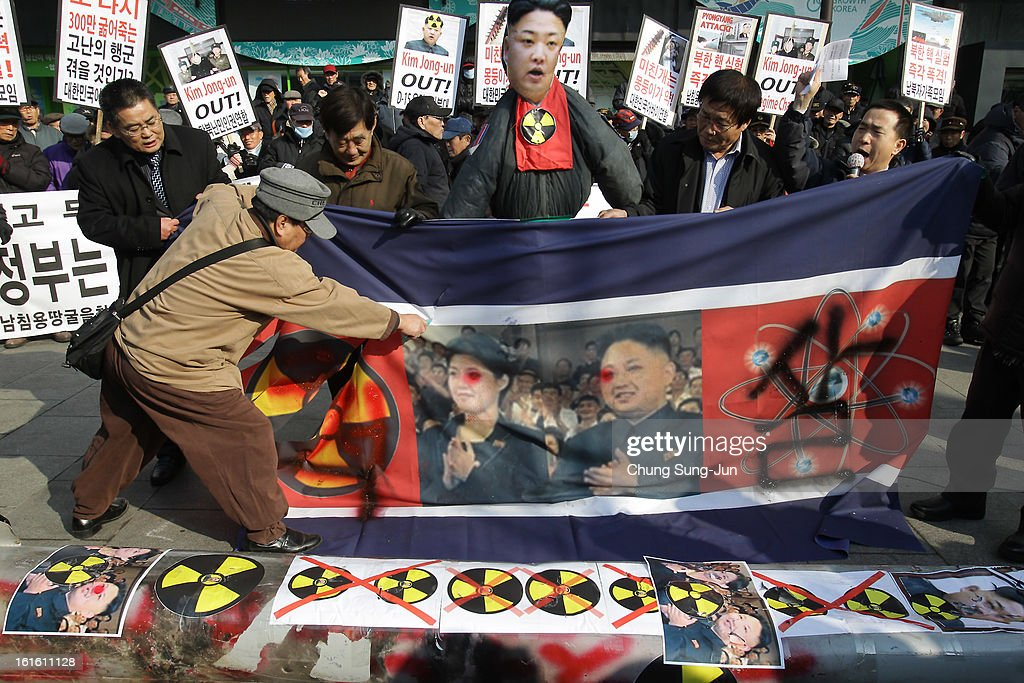 South Korean conservative protesters tear a North Korean flag during a rally a day after North Korea announced they have conducted a third nuclear test on February 13, 2013 in Seoul, South Korea. North Korea claimed the device was smaller than in previous tests. Leaders around the world have condemned the nuclear test and have called for swift action against the reclusive country.