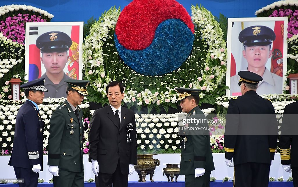 South Korean Defence Minister Han MinKoo and military officers pay tribute to the marines who were killed by North Korea's 2010 attack during a...