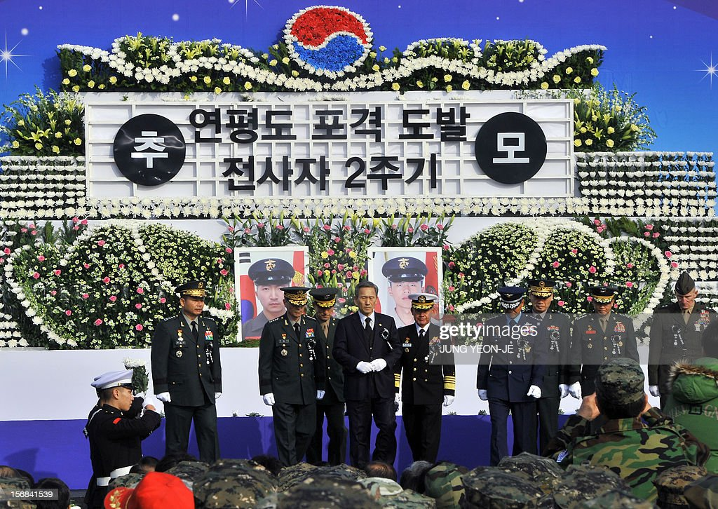 South Korean Defence Minister Kim Kwan-Jin (C) and military officers pay tribute to the marines who were killed by North Korea's 2010 attack, during a ceremony to commemorate the second anniversary of North Korea's shelling of Yeonpyeong Island at the War Memorial in Seoul on November 23, 2012. The November 23, 2010 attack on Yeonpyeong island killed two South Korean marines and two civilians in one of the most serious border incidents since the 1950-1953 Korean War.