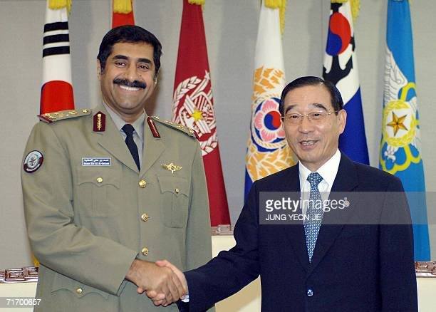 South Korean Defense Minister Yoon KwangUng shakes hands with Qatar's army chief Major General Hamad Bin Ali AlAttiyah during their meeting in the...