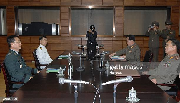 South Korean delegate Army Col Moon SungMook talks with his North Korean counterpart Col Pak RimSu during a military meeting at the North side of the...