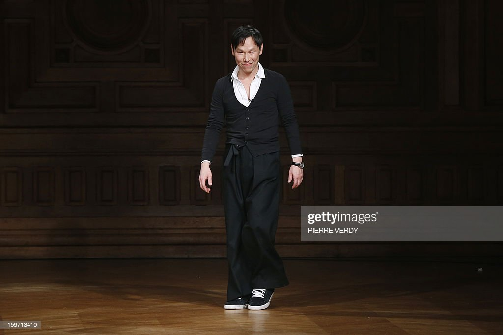 South Korean designer Songzio acknowledges the audience at the end of the men's fall-winter 2013-2014 show on January 19, 2013 during the fashion week in Paris.