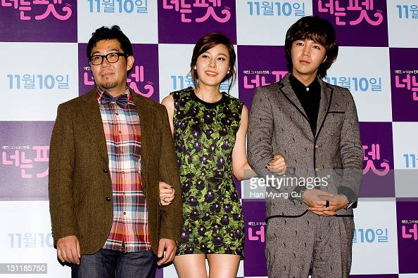 South Korean director Kim ByungGon and actors Kim HaNeul and Jang KeunSuk pose for media during a press conference for 'You're My Pet' at Lotte...