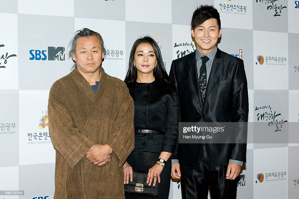 South Korean director Kim Ki-duk, actors <a gi-track='captionPersonalityLinkClicked' href=/galleries/search?phrase=Cho+Min-soo&family=editorial&specificpeople=9692438 ng-click='$event.stopPropagation()'>Cho Min-soo</a> and <a gi-track='captionPersonalityLinkClicked' href=/galleries/search?phrase=Lee+Jung-Jin&family=editorial&specificpeople=9694706 ng-click='$event.stopPropagation()'>Lee Jung-Jin</a> attend during the 2012 Korea Popular Culture Art Awards at Olympic Hall on November 19, 2012 in Seoul, South Korea.