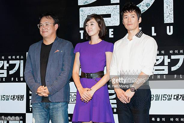 South Korean director Kim SungSu actors Soo Ae and Jang Hyuk attend during 'the Flu' Music Showcase at Platoon Kunsthalle on July 22 2013 in Seoul...