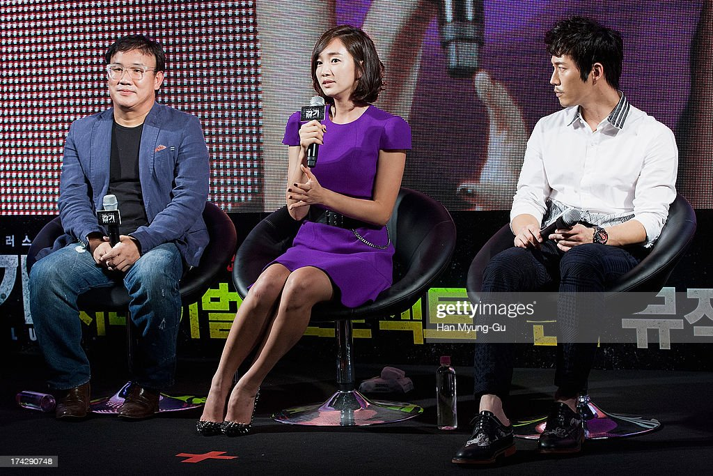 South Korean director Kim Sung-Su (Kim Sung-Soo), actors <a gi-track='captionPersonalityLinkClicked' href=/galleries/search?phrase=Soo+Ae&family=editorial&specificpeople=4357965 ng-click='$event.stopPropagation()'>Soo Ae</a> and <a gi-track='captionPersonalityLinkClicked' href=/galleries/search?phrase=Jang+Hyuk&family=editorial&specificpeople=4466900 ng-click='$event.stopPropagation()'>Jang Hyuk</a> attend during 'the Flu' Music Showcase at Platoon Kunsthalle on July 22, 2013 in Seoul, South Korea. The film will open on August 15 in South Korea.