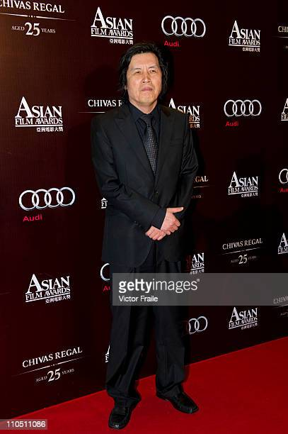 South Korean director Lee Changdong arrives to the 5th Asia Film Awards ceremony at the Convention and Exhibition Centre on March 21 2011 in Hong...
