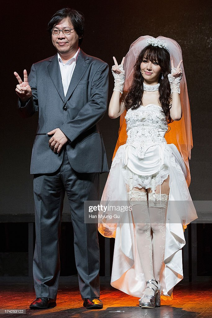 South Korean director Park Chan-Kyung and actress and singer Lee Jung-Hyun pose for media during her Album 'V' Showcase at V-Hall on July 22, 2013 in Seoul, South Korea.