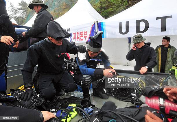 South Korean divers prepare their gear before heading out to sea to the location where a ferry capsized two days ago at a harbor in Jindo on April 18...