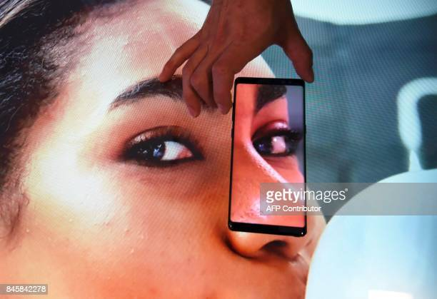 A South Korean employee demonstrates Samsung's Galaxy Note8 during a showcase to mark the domestic launch of Samsung Electronics' latest flagship...