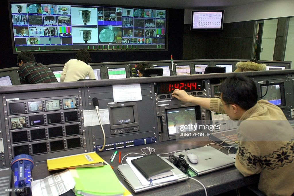 South Korean employees mind the controls at the satellite digital multimedia broadcasting (DMB) center in Seoul, 10 January 2005. South Korea launched trial operations of the world's first satellite-based television service for mobile phone users.