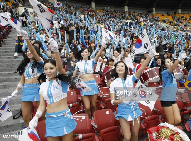 South Korean fans cheers at the Jamshil Stadium in Seoul on March 22 2009 to celebrate their team advance to the final of the World Baseball Classic...