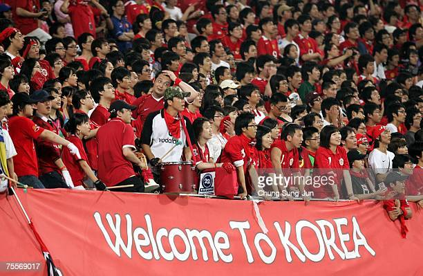 South Korean fans of Manchester United cheers in during the friendly match between FC Seoul and Manchester United at the SangAm World Cup Stadium on...
