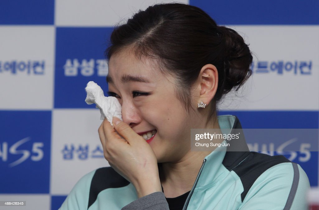 South Korean figure skater Yuna Kim weeps during a news conference held after her farewell ice show on May 6, 2014 in Seoul, South Korea.