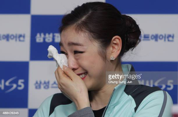 South Korean figure skater Yuna Kim weeps during a news conference held after her farewell ice show on May 6 2014 in Seoul South Korea